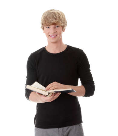 Teen man reading book , isolated on white background