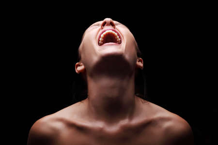 Screaming woman over black background