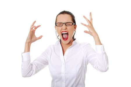 Stressed or angry businesswoman screaming loud