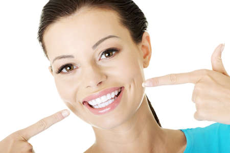 Woman showing her perfect straight white teeth. の写真素材