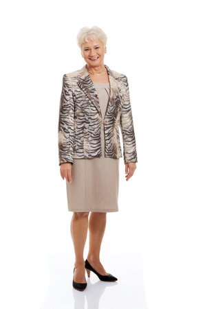 Photo for Friendly fashionable senior woman standing - Royalty Free Image