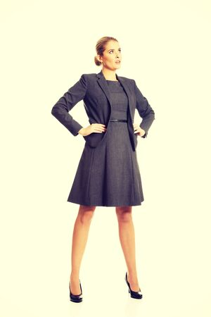 Confident businesswoman standing with her hands on hips.
