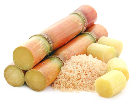 Piece of sugarcane with red sugar over white background