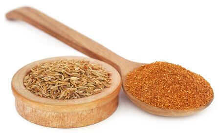 Photo pour Crushed cumin with whole ones over white background - image libre de droit