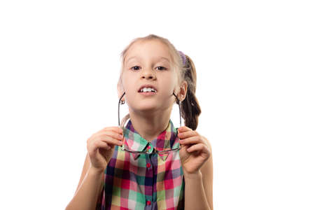 Photo pour Little cute girl in glasses posing on a white background. Child with poor vision - image libre de droit