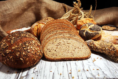 Foto für Assortment of baked bread and bread rolls on rustic table background. - Lizenzfreies Bild