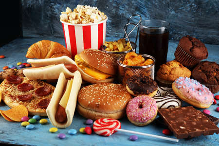 Foto für Unhealthy products. food bad for figure, skin, heart and teeth. Assortment of fast carbohydrates food with fries and cola - Lizenzfreies Bild