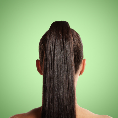 closeup of pony tail. green background