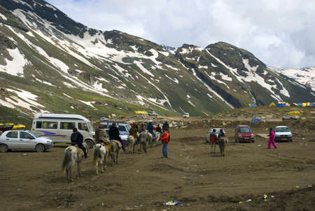 Tourist cars are gathered at the view point of Rothang Pass, India