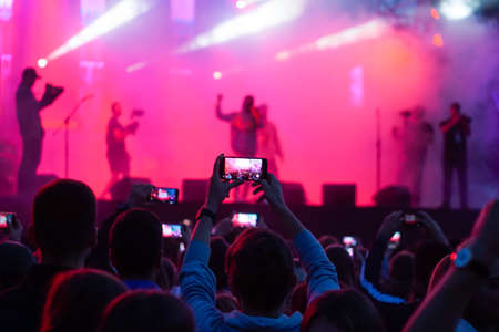 Photo pour Close up of photographing with smartphone during a concert - image libre de droit
