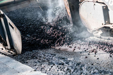 Photo for Industrial pavement machine laying fresh asphalt on highway - Royalty Free Image
