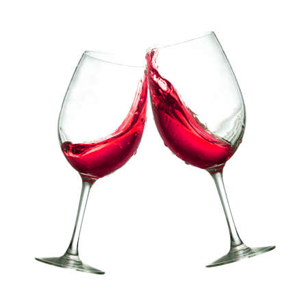 Toasting of two red wine clear glasses