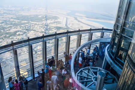Dubai, United Arab Emirates -November 5, 2015: tourists looking Aerial view of Downtown Dubai  from the tallest building in the world, Burj Khalifa