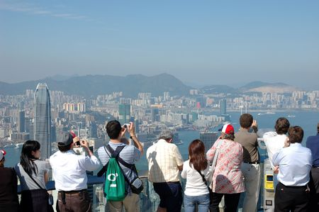 Tourists sightseeing the Hong Kong skyline at the Peak
