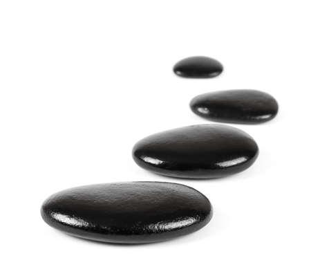 Black stones over white background