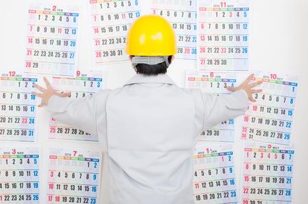 Photo pour Men of work clothes,calendar - image libre de droit