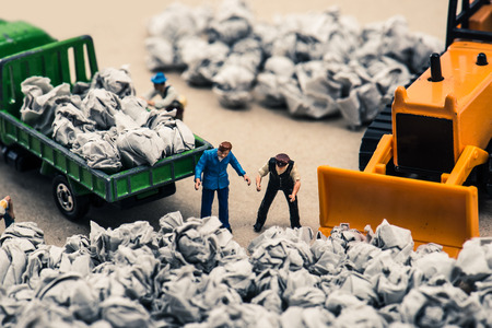 Photo for Garbage and miniature dolls - Royalty Free Image