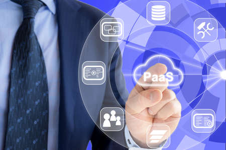 IT expert in a blue suit is pressing a glowing cloud symbol with PaaS, Platform as a service and icons of services around