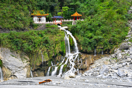 Changuang temple in Taroko National Park with a waterfall