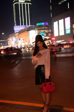 Beautiful woman talking on cellular telephone  at night