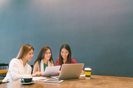 Photo for Three beautiful Asian girls using laptop in team business meeting, coworkers or college student, startup project discussion or teamwork brainstorm concept, coffee shop or modern office with copy space - Royalty Free Image