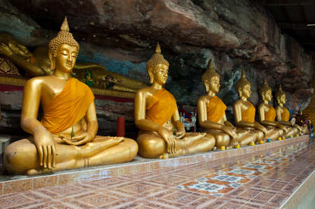 Buddha on stone babkground in cave of Thailand