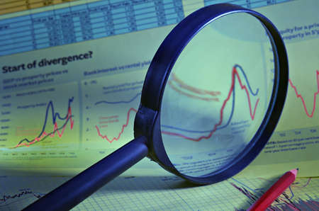 Magnifier against financial schedules and tables of the data
