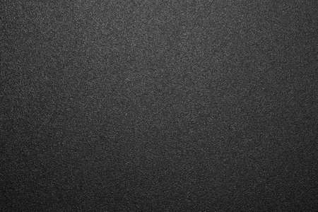 Photo pour Texture of black matte plastic. Black and white matte background. - image libre de droit