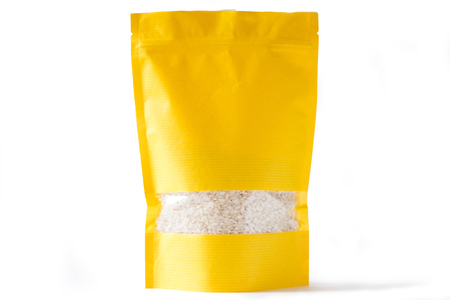 Photo pour yellow paper doypack stand up bio pouch with window  zipper on white background filled with rice - image libre de droit