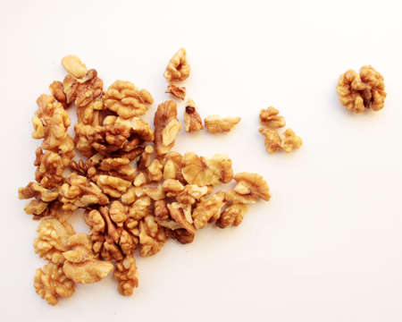 Peeled walnuts on a white background