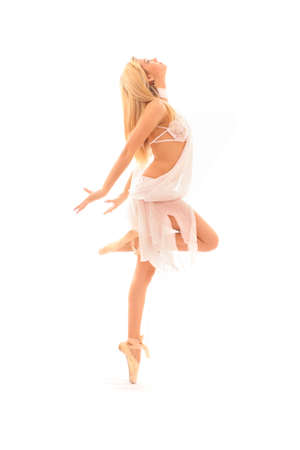 young and beautiful ballerina in white dress over white background