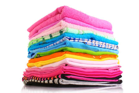 Pile of colorful clothes over white background
