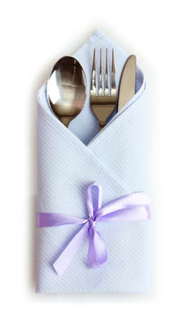 cutlery and napkin isolated on white