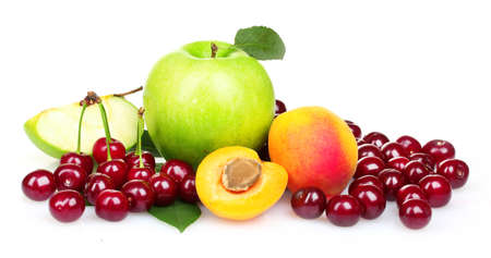 Beautiful apples, apricots and cherries isolated on white