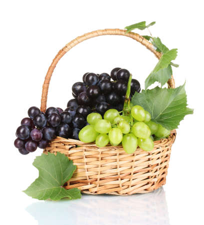 Ripe red grapes in basket isolated on white