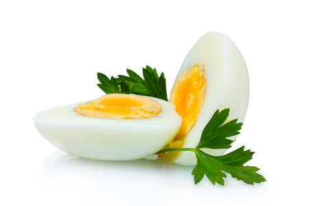 tasty boiled egg and parsley isolated on white