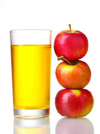 Delicious apple juice in glass and apples isolated on whiteの写真素材