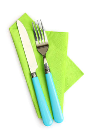 knife and fork on a napkin isolated on white