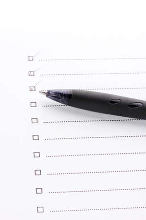 Checklist and pen closeup
