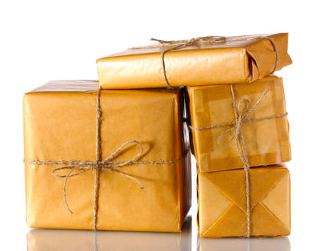 Many parcels wrapped in brown paper tied with twine isolated on white