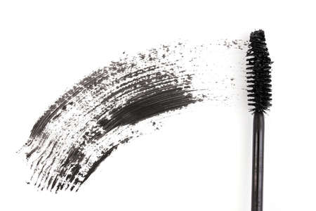 Black mascara brush stroke isolated on white