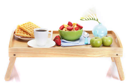light breakfast on wooden tray isolated on white
