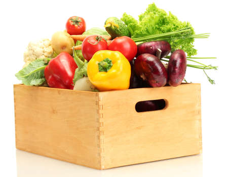Fresh vegetables in wooden box isolated on whiteの写真素材