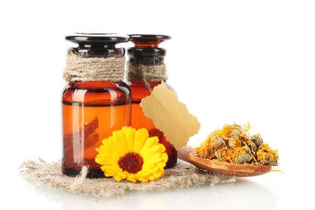 medicine bottles and calendula, isolated on white