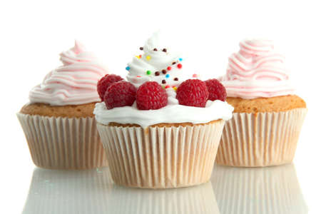 tasty cupcakes with berries, isolated on white