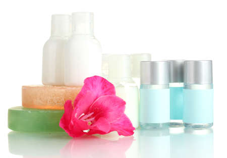 cosmetic bottles, soap and flower, isolated on white