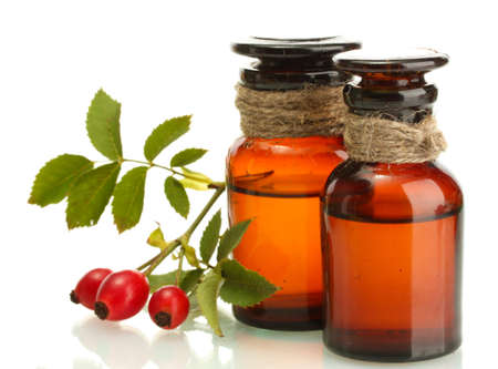 medicine bottles with hip roses, isolated on white