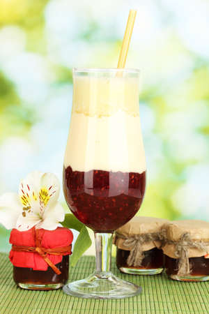 Delicious fruit smoothie on bright background