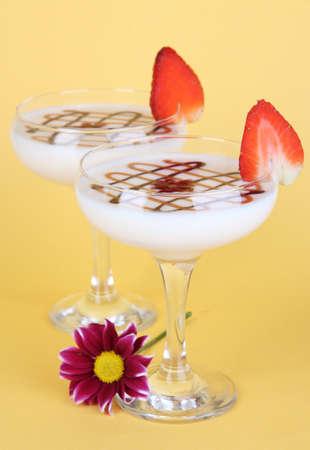 Fruit smoothies on beige background