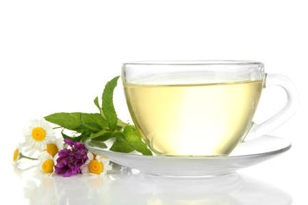 Cup of herbal tea with wild flowers and mint, isolated on white